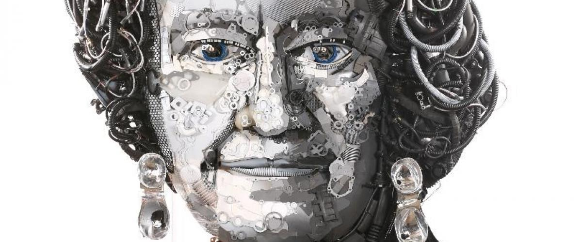 A giant portrait of Her Majesty the Queen, created entirely out of car and truck parts